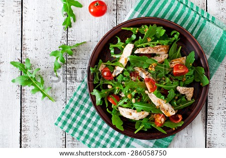 Fresh salad with chicken breast, arugula and tomato. Top view #286058750