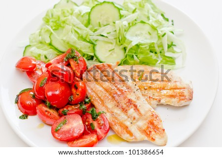 Fresh salad with chicken breast,lettuce and tomatoes - stock photo