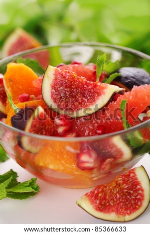 Fresh salad with figs, grapefruit, tangerine and pomegranate with dressing of honey and juice