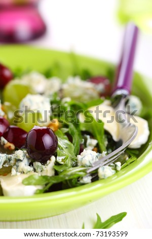 Fresh salad with grapes, blue cheese and goat cheese, dressing with walnut