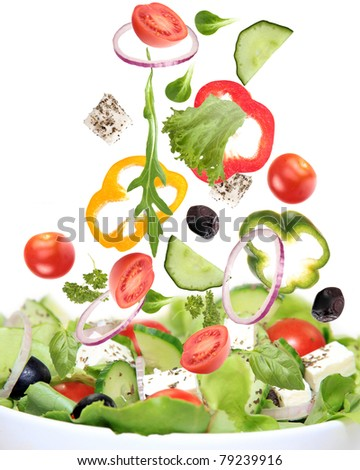 Fresh salad with ingredients in motion