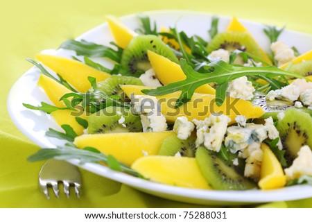 Fresh salad with mango, kiwi and blue cheese