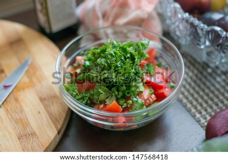 Fresh salad with onions, cucumber and parsley