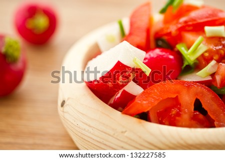 fresh salad with radishes and tomatoes with herbs
