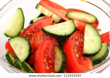 Fresh salad with tomatoes and cucumbers close-up