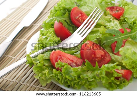 Fresh salad with tomatoes and salad