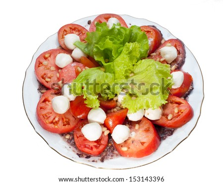 Fresh salad with tomatoes, onion and nuts