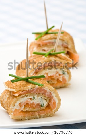 Fresh salmon and cream cheese canapes with chives