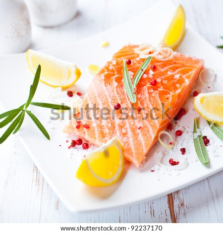 Fresh salmon fillet with sea salt and pink peppercorns