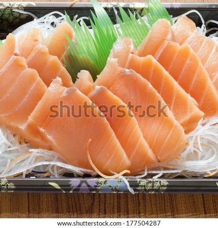 fresh salmon piece for sushi on wood background #177504287