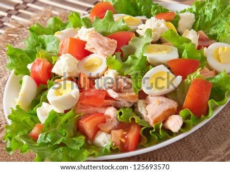 fresh salmon salad, lettuce and quail eggs