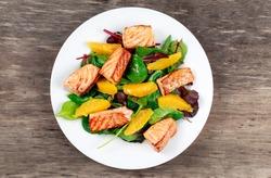 Fresh Salmon Salad with vegetables and orange