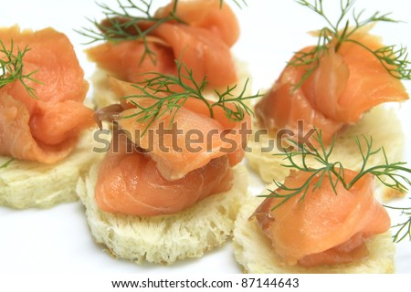 Fresh salmon slice on bread decorate with dill