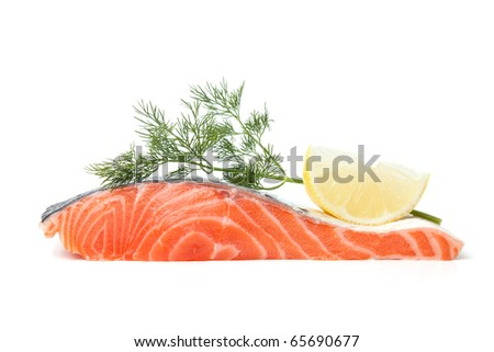 Fresh salmon steak with lemon slice and dill. Isolated on white background