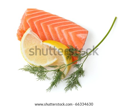 Fresh salmon steak with lemon slices and dill. Isolated on white background