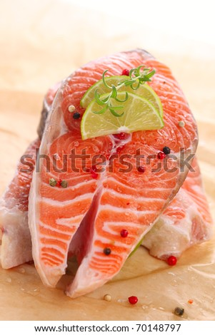 Fresh salmon steak with pepper and lime