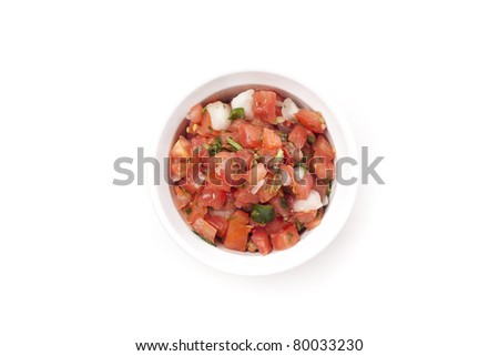 Fresh salsa in a bowl against a white background
