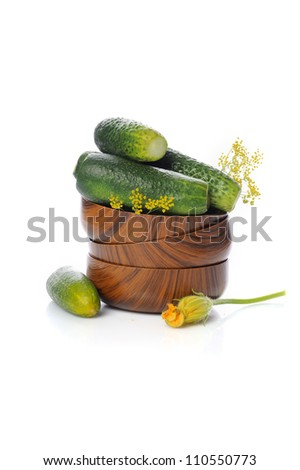 Fresh salted cucumbers in bowl