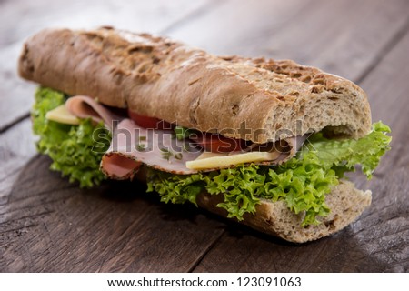 Fresh Sandwich with Ham and Cheese decorated with fresh tomatoes - stock photo