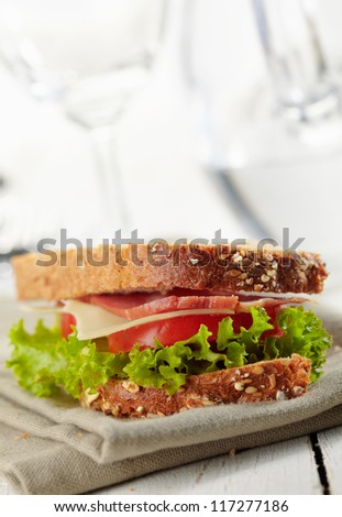 fresh sandwich with tomatoes, swiss cheese, lettuce