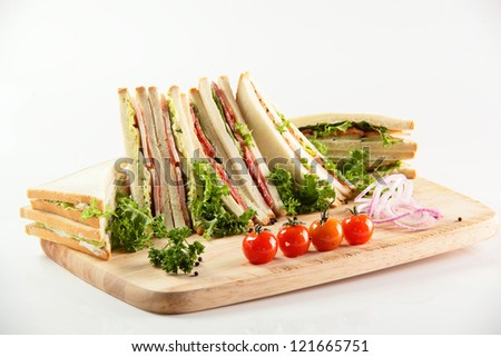 fresh sandwiches on wooden desk and white background