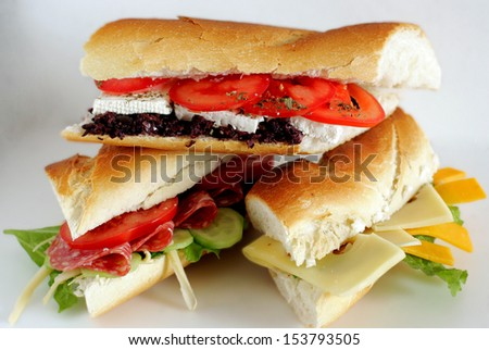 Fresh sandwiches with cheese, tomato, meat and lettuce.