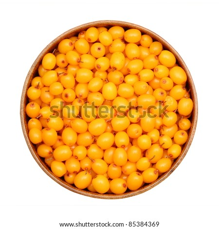 Fresh sea buckthorn berry in a wooden bowl