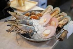 Fresh seafood. Seafood is any form of sea life regarded as food by humans. Seafood prominently includes fish and shellfish. Shellfish include various species of molluscs, crustaceans, and echinoderms.