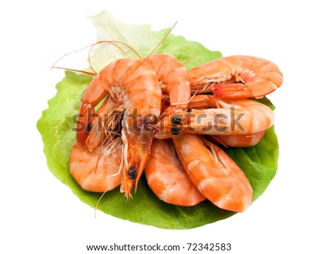 Fresh shrimp on lettuce leaf, isolated on a white background