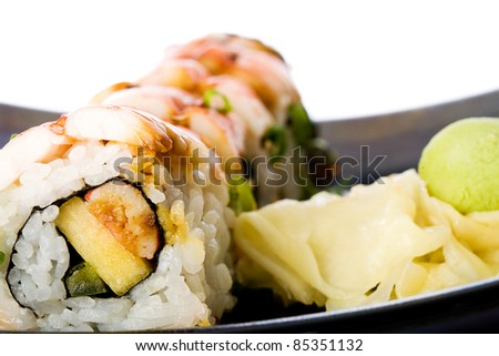 Fresh Shrimp Sushi Rolls at an Asian restaurant with pickled ginger and wasabi.