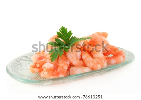 fresh shrimp with parsley on a white background