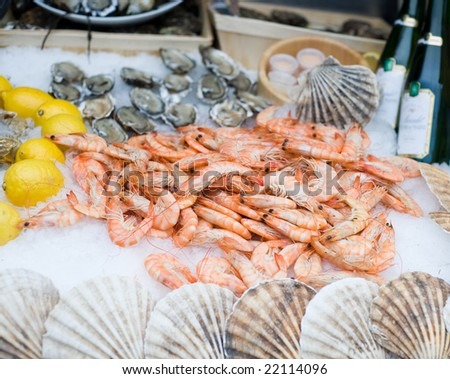 fresh shrimps on ice with lemon and oysters