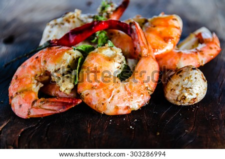 Shutterstock fresh shrimps served on a wood plate with garlic onion and chili