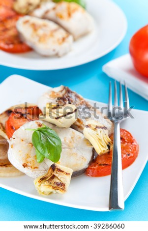 fresh slice of hake baked with vegetables