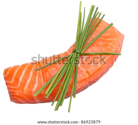 Fresh slice of salmon with chives isolated on white background