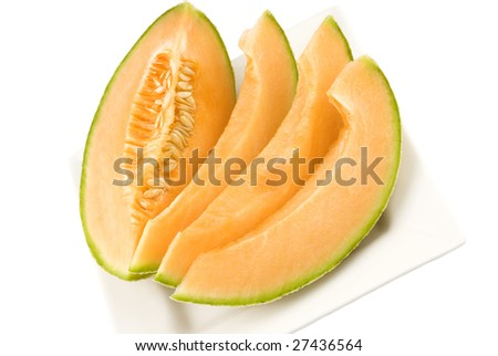Fresh sliced cantaloupe on a plate with white background and copy space - stock photo