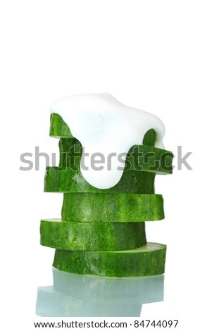 fresh sliced ??cucumber and sour cream isolated on white - stock photo