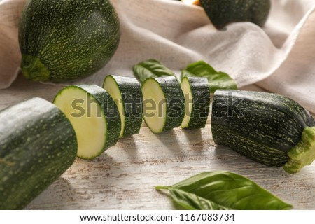 Fresh sliced zucchini on wooden table #1167083734