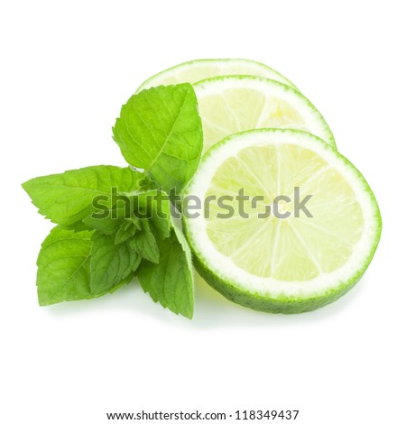 Fresh slices of lime with mint isolated on a white background - stock photo