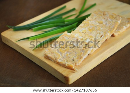 Fresh slices of tempe on the wooden background Photo stock ©