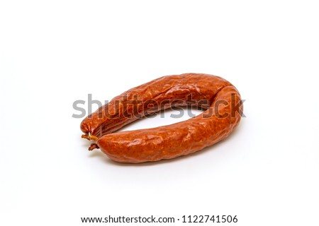 fresh smoked sausage, horseshoe shape on the white background