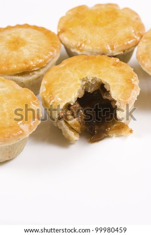 Fresh steak pies, one of them open