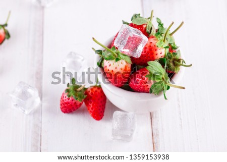 Stock Photo Fresh strawberries in a bowl on wooden table