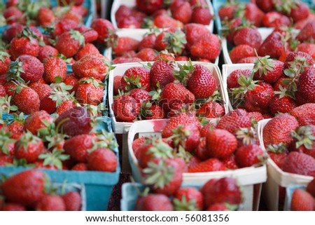 Fresh strawberries in baskets at market