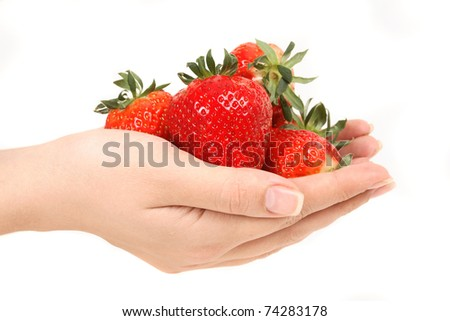 Fresh strawberries in hands against white background