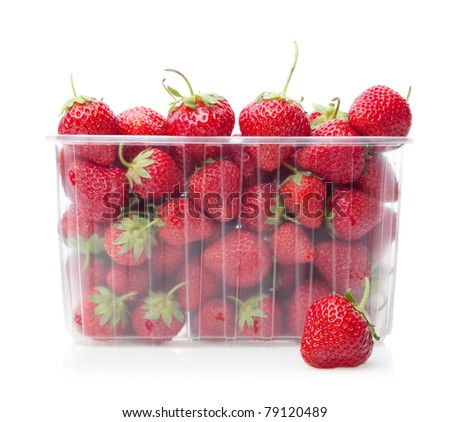 Fresh strawberries in plastic box on white background.