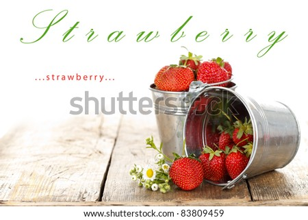 Fresh strawberries in silver pots with flower, rustic style, place for your text up