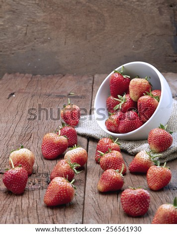 Fresh strawberries on old wooden background  #256561930