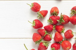 Fresh strawberries on white wooden table. Top view