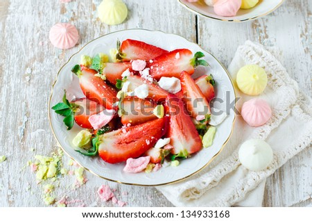 Fresh strawberries with pieces of meringue. Selective focus